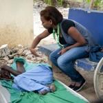Josefina Herrera folds clothes for Americana Pimentel at Casa de Ancianos Bettel in Monte Christy, Dominican Republic.