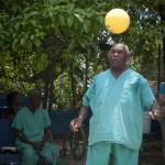 Enoc Jackson plays soccer outside a mobile clinic in Monte Christy, Dominican Republic.