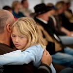Anna Ring hugs her dad during a service at the Sierra Vista Cowboy Church on January 8, 2012.