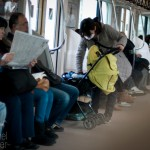 Tokyo residents travel by train to downtown Tokyo on March 11, 2012.
