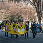 Volunteers with Reseednow walk through Hibiya Park protesting the use of nuclear energy on March 11, 2012, in Tokyo, Japan.