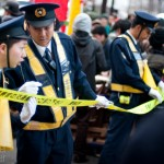 Police secure streets and sidewalks during an anti-nuclear protest in Tokyo, Japan, on March 11, 2012.