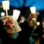Hundreds of people held hands while holding candles to form a human chain around the National Diet Building in Tokyo, Japan, on March 11, 2012, in remembrance of tsunami victims.